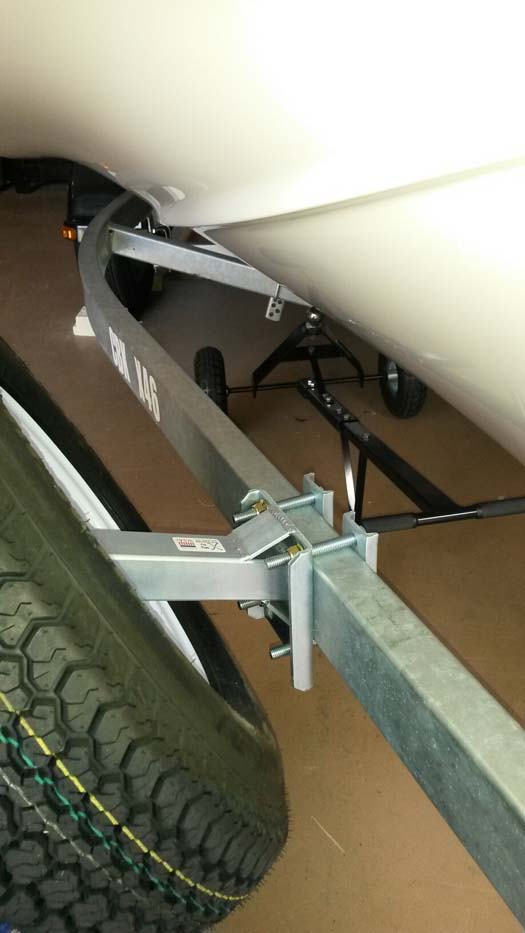 Spare Tire Carrier, SM-97; Large, Offset, Locking (side view) On Trailer w/ boat