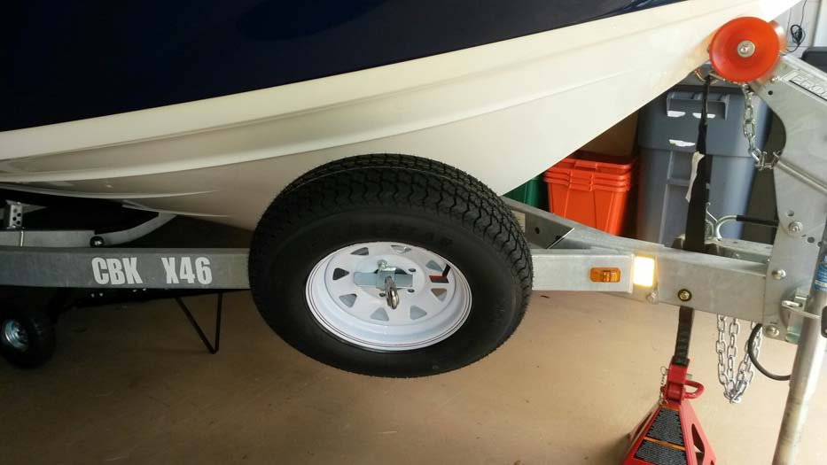 Spare Tire Carrier, SM-97; Large, Offset, Locking (front view) On Trailer w/ boat