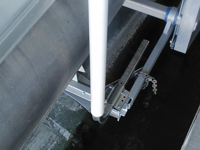 "T-965-G; Galvanized 65"" Post Guide-On mounted on Boat Lift/Hoist (close up)(2)."